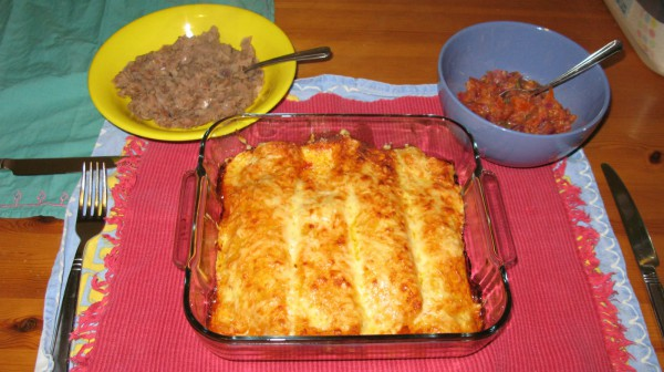 chicken enchiladas and refried beans